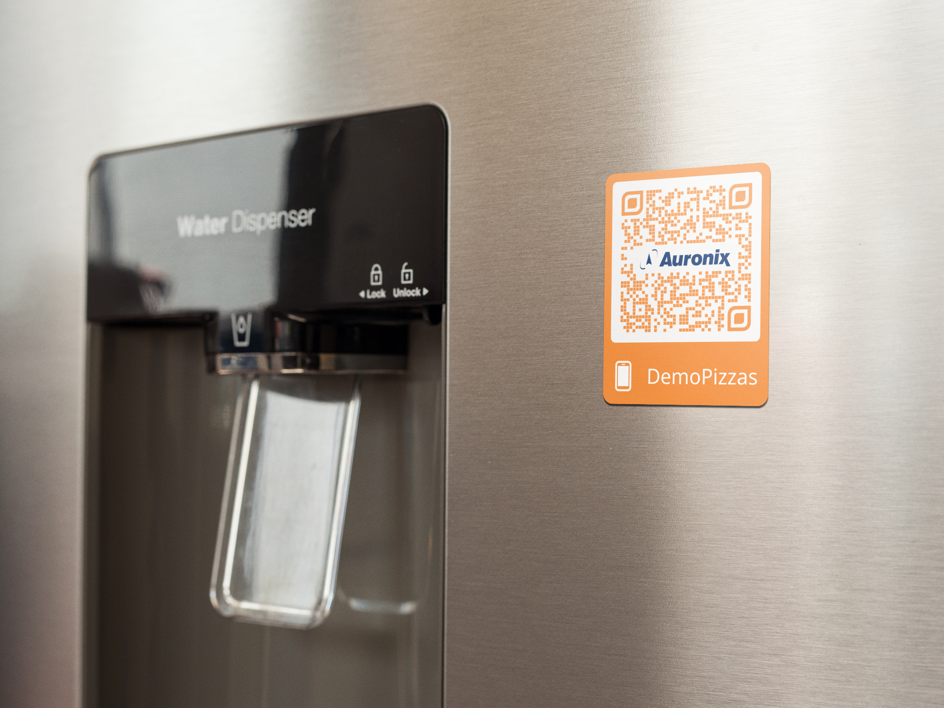 fridge-magnet-mockup-on-a-metallic-fridge-near-the-water-dispenser-a14790